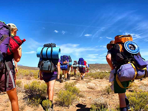 Backpackers trekking through stunning landscape