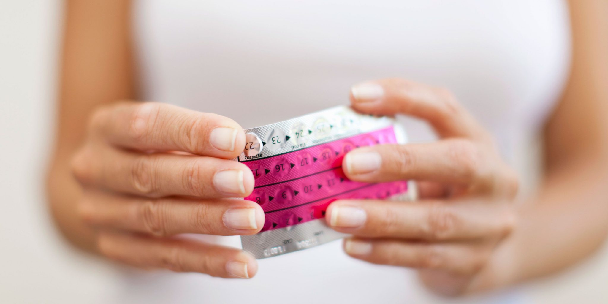 Woman's hands holding contraceptive pill packet